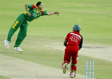 Mashrafe Mortaza acrobatically fends off a ball from Elton Chigumbura in the third ODI against Zimbabwe at Harare
