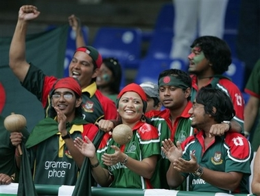 Colorful fans cheer as the Tigers take on Bermuda. &#0169 AP